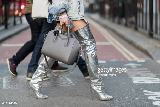 A guest wearing a grey Givenchy bag silver overknees outside Emilia Wickstead on day 2 of the London Fashion Week February 2017 collections on...