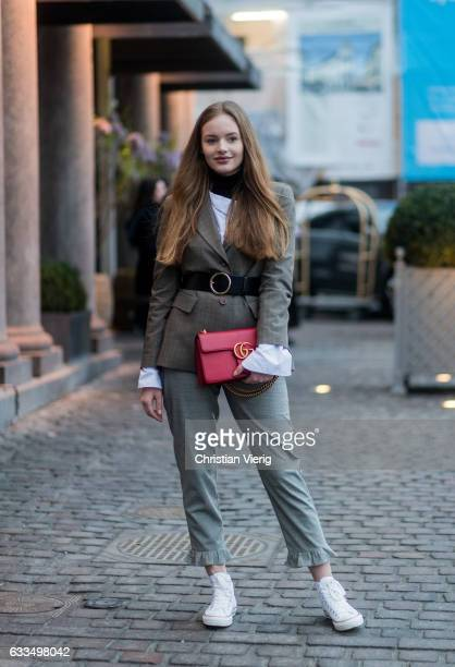 A guest wearing a grey suit and red Gucci bag outside Freya Dalsjo at the Copenhagen Fashion Week Autumn/Winter 17 on February 1 2017 in Copenhagen...