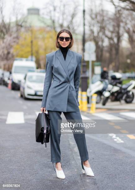 A guest wearing a grey suit outside Chanel on March 7 2017 in Paris France