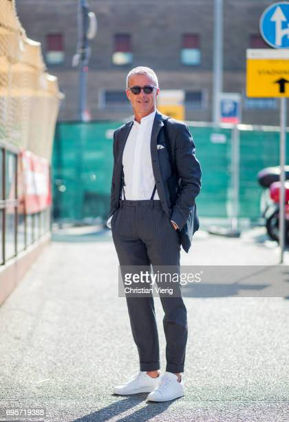 A guest wearing a grey suit with suspenders is seen during Pitti Immagine Uomo 92 at Fortezza Da Basso on June 13 2017 in Florence Italy