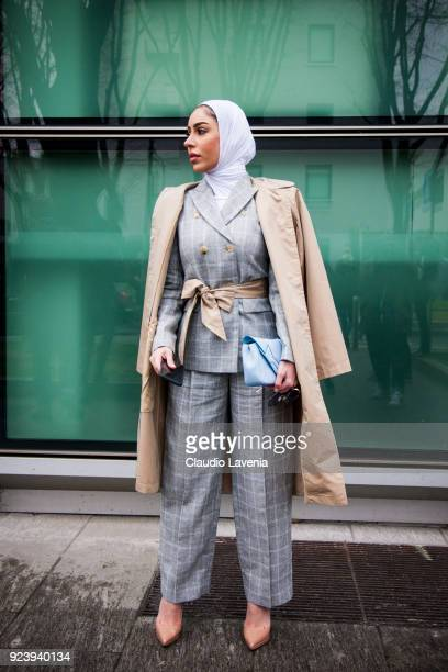 Guest wearing a grey tailleur is seen outside Giorgio Armani show during Milan Fashion Week Fall/Winter 2018/19 on February 24 2018 in Milan Italy