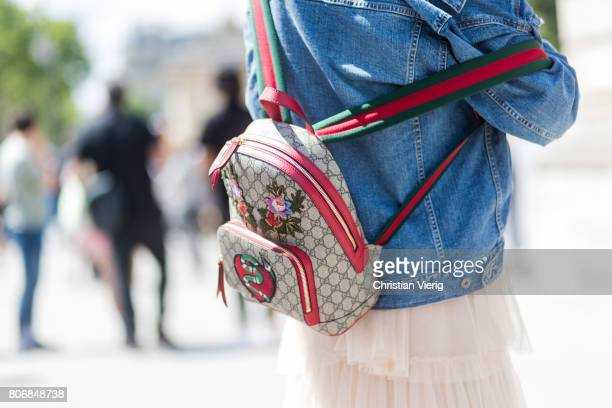 A guest wearing a Gucci backpack outside Dior during Paris Fashion Week Haute Couture Fall/Winter 20172018 Day Two on July 3 2017 in Paris France