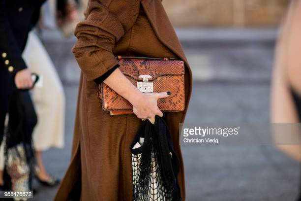 Guest wearing a Gucci bag during Mercedes-Benz Fashion Week Resort 19 Collections at Carriageworks on May 14, 2018 in Sydney, Australia.