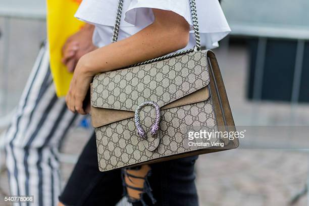 A guest wearing a Gucci bag during Pitti Uomo 90 on June 16 in Florence Italy