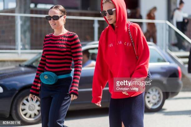 A guest wearing a Gucci velvet belt bag and a guest wearing a red hoody outside By Malene Birger on August 09 2017 in Copenhagen Denmark