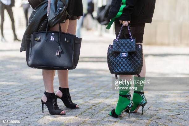 A guest wearing a Hermes bag and a Chanel bag and heels outside Munthe on August 09 2017 in Copenhagen Denmark