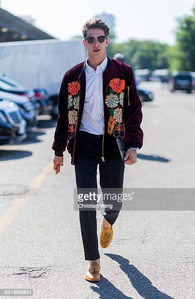 A guest wearing a jacket with floral prints outside Diesel during the Milan Men's Fashion Week Spring/Summer 2017 on June 20 2016 in Milan Italy