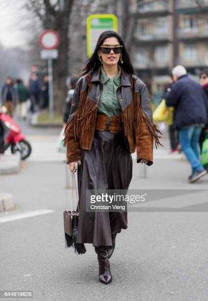 A guest wearing a jacket with fringes outside Fendi during Milan Fashion Week Fall/Winter 2017/18 on February 23 2017 in Milan Italy