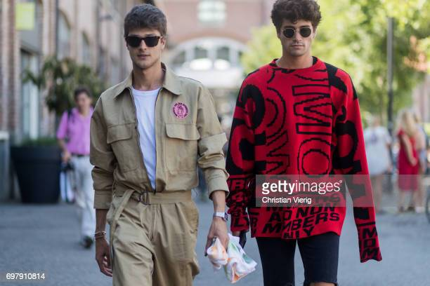 A guest wearing a khaki jumpsuit and a guest wearing a red oversized sweater ripped denim jeans is seen outside Malibu 1992 during Milan Men's...
