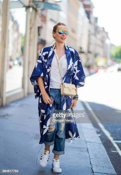 A guest wearing a kimono during the London Fashion Week Men's June 2017 collections on June 10 2017 in London England