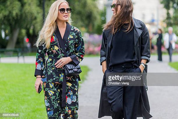 Guest wearing a kimono with floral print and Chanel bag and a leather trench coat outside Daisy Grace during the third day of the Stockholm Fashion...