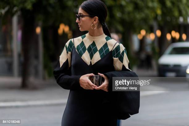 Guest wearing a knit and black dress, earings outside Rodebjer on August 30, 2017 in Stockholm, Sweden.