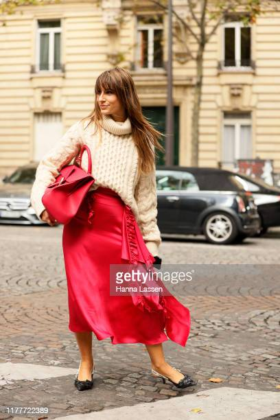 A guest wearing a knit top pink silky skirt and Dior shoes outside the Altuzarra show during Womenswear Spring/Summer 2020 show Paris Fashion Week on...