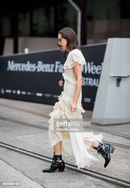 A guest wearing a laced dress and white bag with fringes during MercedesBenz Fashion Week Resort 19 Collections at Carriageworks on May 16 2018 in...