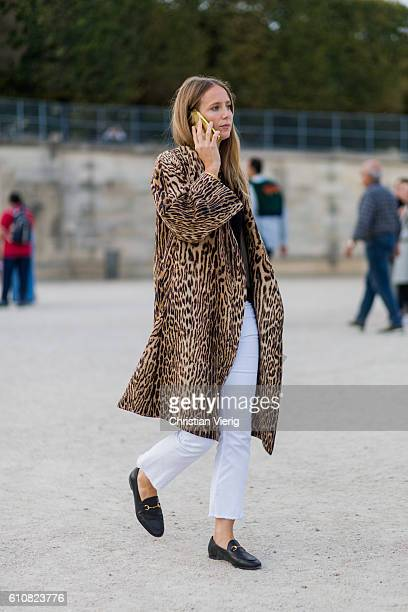 A guest wearing a leo print coat outside Jacquemus on September 27 2016 in Paris France