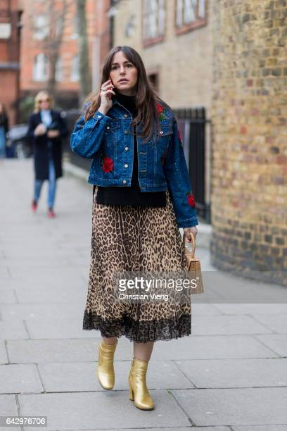 A guest wearing a leopard print skirt denim jacket golden ankle boots outside Anya Hindmarch on day 3 of the London Fashion Week February 2017...