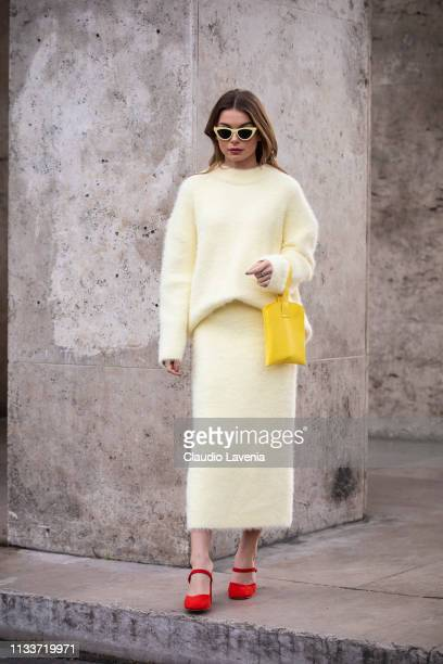 A guest wearing a light yellow jumper with matching skirt red heels and yellow bag is seen outside Sacai on Day 8 Paris Fashion Week Autumn/Winter...