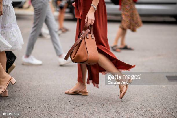 Guest wearing a Loewe bag is seen outside Cecilie Bahnsen during the Copenhagen Fashion Week Spring/Summer 2019 on August 8, 2018 in Copenhagen,...