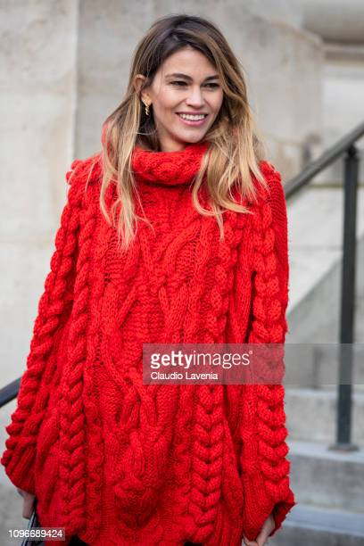 Guest, wearing a long red knitted jumper, is seen in the streets of Paris after the Sacai show on January 19, 2019 in Paris, France.