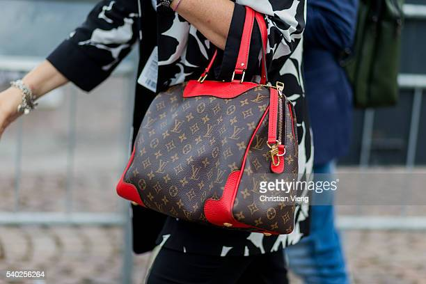 A guest wearing a Louis Vuitton bag during Pitti Uomo 90 on June 14 in Florence Italy