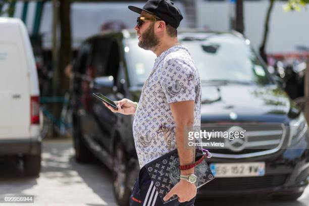 A guest wearing a Louis Vuitton button shirt outside Louis Vuitton during Paris Fashion Week Menswear Spring/Summer 2018 on June 22 2017 in Paris...