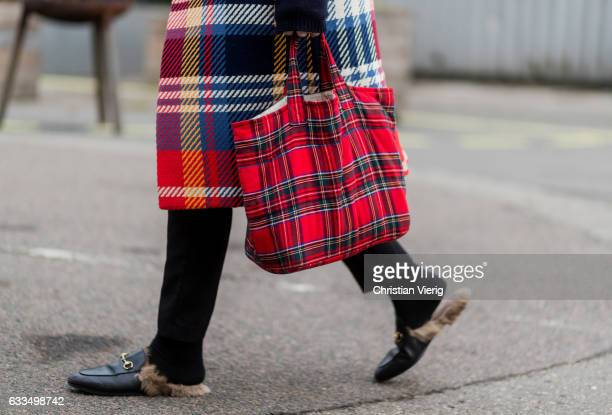 A guest wearing a lumberjack checked bag Gucci loafers outside Tonsure at the Copenhagen Fashion Week Autumn/Winter 17 on February 1 2017 in...