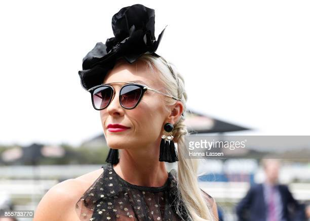 A guest wearing a Morgan Taylor fascinator Italian vintage sunglasses Lovisa earrings and an Alice McCALL dress at TAB Epsom Day at Royal Randwick...