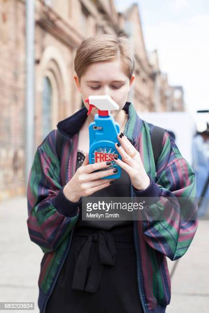 Guest wearing a Moschino phone case during MercedesBenz Fashion Week Resort 18 Collections at Carriageworks on May 15 2017 in Sydney Australia