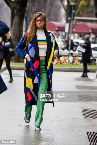 Guest wearing a multicolor coat is seen outside Giorgio Armani show during Milan Fashion Week Fall/Winter 2018/19 on February 24 2018 in Milan Italy