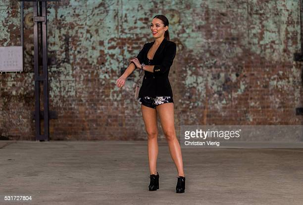 A guest wearing a navy blazer and shorts outside Misha Collection at MercedesBenz Fashion Week Resort 17 Collections at Carriageworks on May 16 2016...