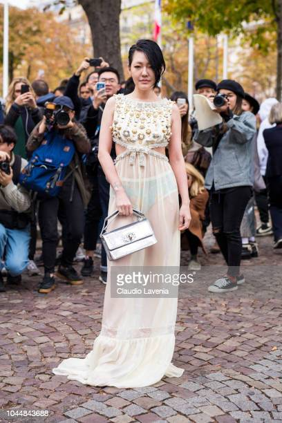 A guest wearing a nude embellished dress is seen before the Miu Miu show on October 2 2018 in Paris France