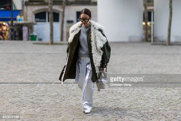 A guest wearing a parka silver pants Loewe bag outside Vetements on January 24 2017 in Paris Canada
