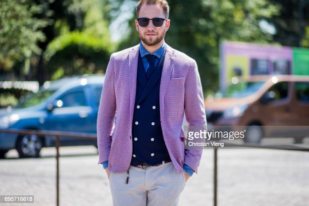 Guest wearing a pink blazer jacket is seen during Pitti Immagine Uomo 92. At Fortezza Da Basso on June 13, 2017 in Florence, Italy.