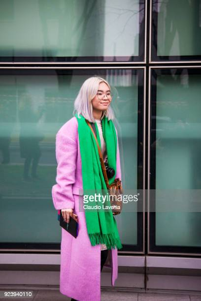 Guest wearing a pink coat and green scarf is seen outside Giorgio Armani show during Milan Fashion Week Fall/Winter 2018/19 on February 24 2018 in...