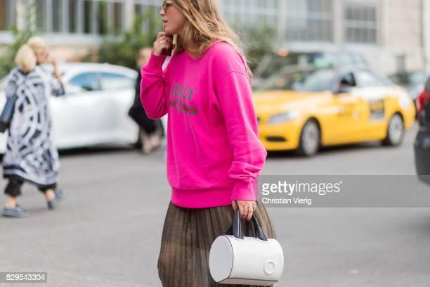 A guest wearing a pink Gucci sweater outside Ganni on August 10 2017 in Copenhagen Denmark