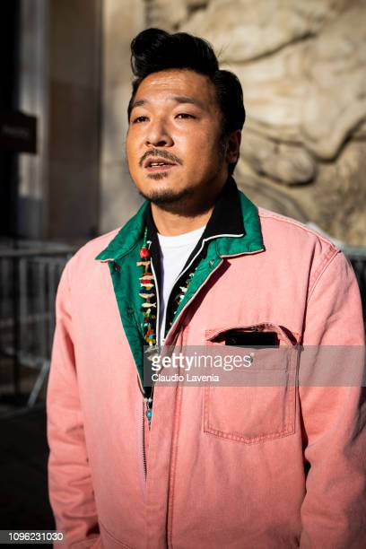 Guest, wearing a pink jumpsuit, is seen in the streets of Paris before the Ann Demeulemeester show on January 18, 2019 in Paris, France.