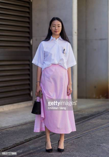 A guest wearing a pink long skirt at day 3 during MercedesBenz Fashion Week Resort 18 Collections at Carriageworks on May 16 2017 in Sydney Australia