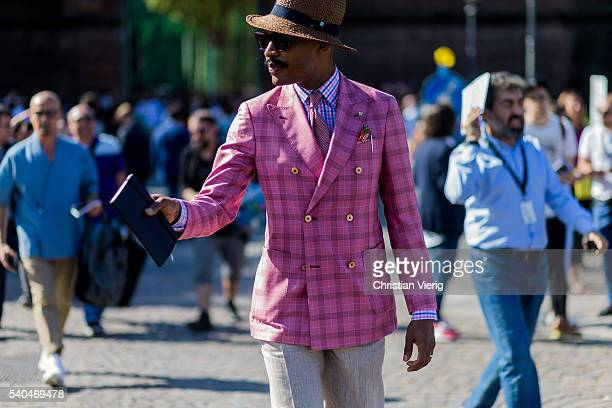 A guest wearing a pink plaid blazer jacket during Pitti Uomo 90 on June 15 in Florence Italy