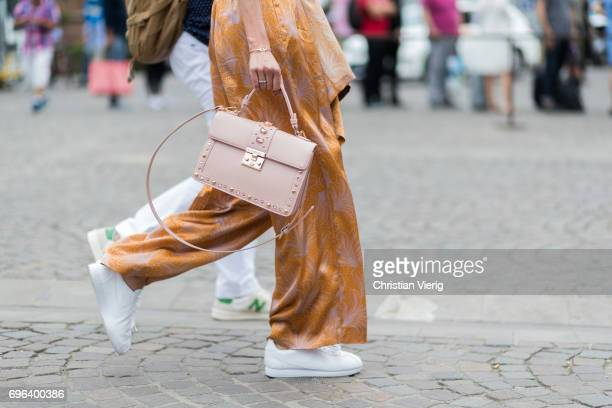 A guest wearing a pink Pomikaki bag is seen during Pitti Immagine Uomo 92 at Fortezza Da Basso on June 15 2017 in Florence Italy