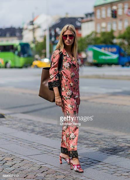 A guest wearing a pink pyjama suit with floral print outside Designers Nest during the first day of the Copenhagen Fashion Week Spring/Summer 2017 on...