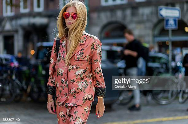 A guest wearing a pink pyjama suit with floral print outside Fonnesbech during the first day of the Copenhagen Fashion Week Spring/Summer 2017 on...