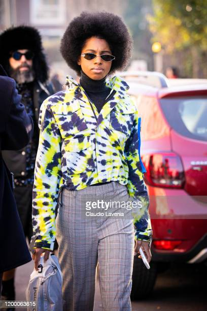 A guest wearing a printed jacket and checked pants is seen outside the MSGM show during the Milan Men's Fashion Week on January 12 2020 in Milan Italy