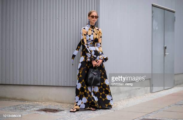 A guest wearing a printed maxi dress seen outside Stine Goya during the Copenhagen Fashion Week Spring/Summer 2019 on August 8 2018 in Copenhagen...