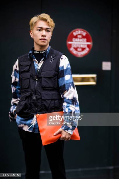 Guest, wearing a printed shirt, black vest and yellow purse, is seen outside the Faith Connexion show during Paris Fashion Week - Womenswear Spring...