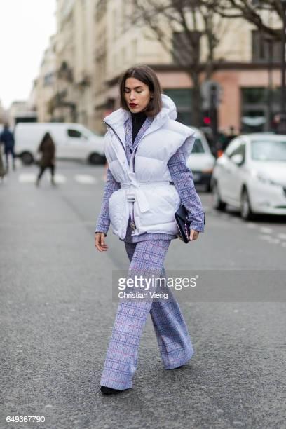 Guest wearing a purple suit, white vest outside Moncler on March 7, 2017 in Paris, France.