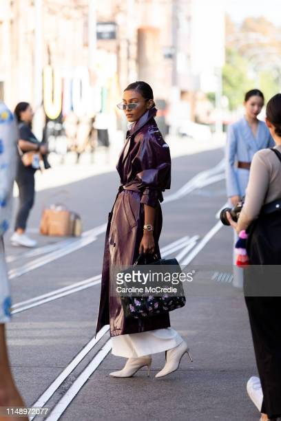 A guest wearing a purple trench coat attends MercedesBenz Fashion Week Resort 20 Collections on May 14 2019 in Sydney Australia