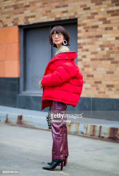 A guest wearing a red down feather jacket outside Anna Sui on February 15 2017 in New York City