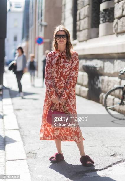 A guest wearing a red dress and Gucci bag outside Moods of Norway on August 22 2017 in Oslo Norway