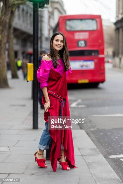 A guest wearing a red dress outside Roksanda on day 4 of the London Fashion Week February 2017 collections on February 20 2017 in London England