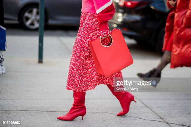 A guest wearing a red Ferragamo bag seen outside 31 Phillip Lim on February 12 2018 in New York City